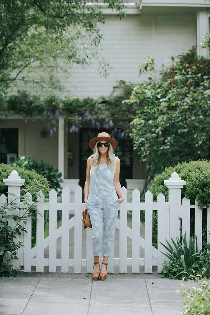 Revolve Overalls with White tank and hat