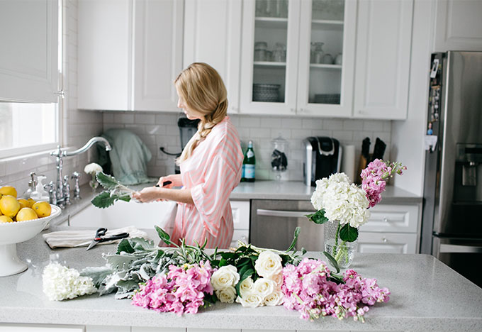 cutting flowers in kitchen wearing victoria's secret robe