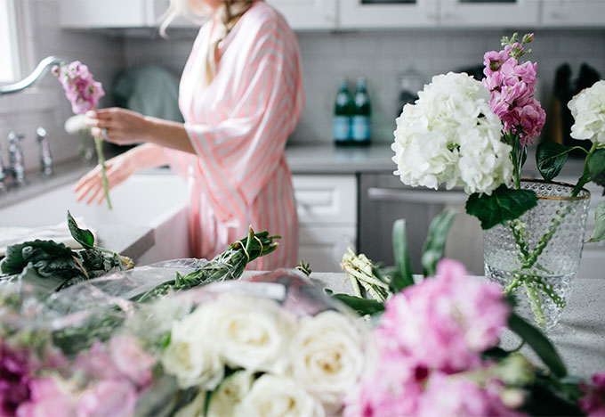pink and white robe cutting flowers
