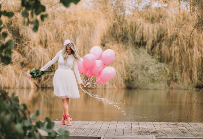 erika from whiskey and lace in white tulle skirt and pink balloons