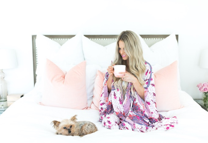 Erika Altes from Whiskey and Lace blog wearing Anthropologie robe while having coffe in bed