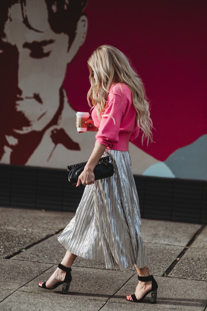 Erika Altes from Whiskey and Lace blog wearing a pleated metallic skirt with pink cropped sweater