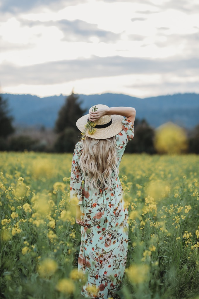 Erika Altes from Whiskey and Lace blog wearing floral maxi dress from Anthropologie in mustard fields