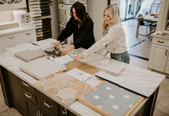 Ceramic Tile Center by popular SoCal life and style blog, Whiskey and Lace: image of a woman looking at various tile samples at the Ceramic Tile Center.